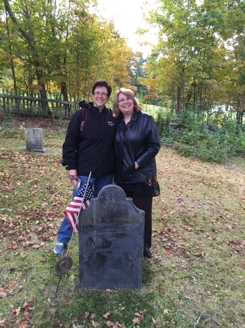 Lauren and Sherece meet at Case Cemetery next to the gravestone of their 5th great grandfather, John Day