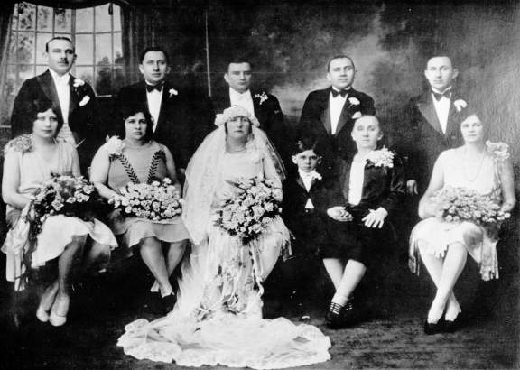 "Back Row (L-R) - Herman Benjamin ""Ben"" Meiselman, Isador ""Isaac"" Miselman, Solomon Augenlicht, Louis Meiselman, Jacob ""Jack"" Meiselman; Front Row (L-R); Clara (Kahn) Meiselman, wife of Ben; Rosa Brown, wife of Isaac; Lottie (Meiselman) Augenlicht; Michael Meiselman (son of Jacob and Pauline); Chajcie (AKA ""Ida"" or ""Clara"" [Hackmeyer/Hackmayer]) Meiselman, mother of Meisleman brothers in back row, and Pauline (Sternburg) Meiselman, wife of Jacob and mother of Michael."