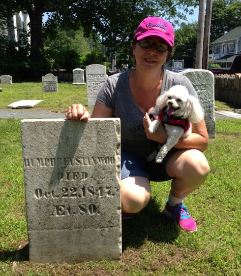Posing for photos with tombstones is perfectly normal activity.