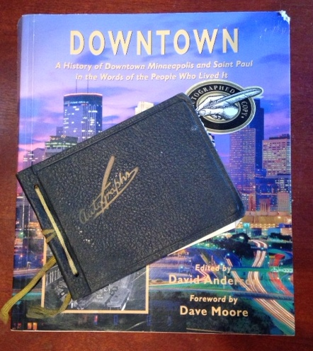 Downtown, a book about Minneapolis, and Grammer's autograph book, provide clues to the mystery