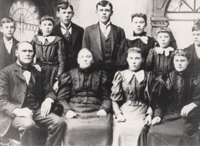 Front: Haldor, Gunhild, Elizabeth and Anna.  Back: Gabriel, Margret, Lars, Ole, Martha, Cecilia, and Harry.
