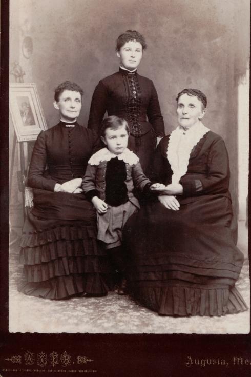 Harriet L. (Day) Freeman (right), Lucy Ann Day (Freeman) Whitten (left), Carrie (Whitten) Whitten standing, and Guy Whitten, center
