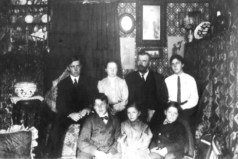 Circa 1872, William H. Maling, age 47 and Joanna A. Maling, age 37 (back row center) with their oldest five children at the Maling family home in Brewer, ME. Back row at left: George W. age 21, on right Melvin E. age 17. Front row from left; Jerome S. age 14, Lillian A. age 7 and John B. age 11.