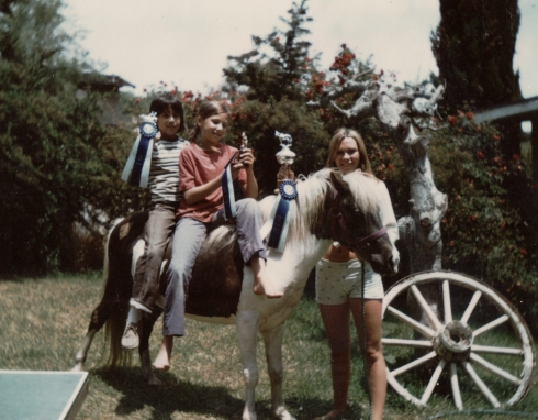 "Me, about 1974 (sitting on my pony, ""Charlie"") with my cousin Jeff behind me, and my aunt Robyn standing."