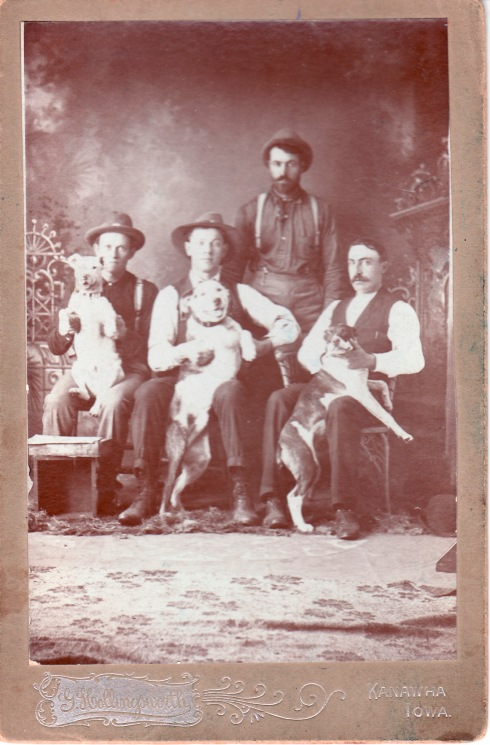 My great grandfather, Ernest L. Simpson, far right, with his dog.