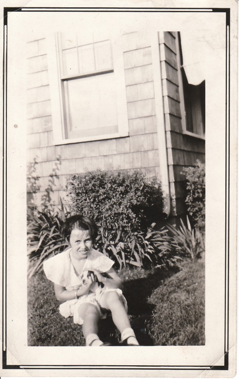 My grandmother, Goldie, probably 1926/7, holding a young pup.