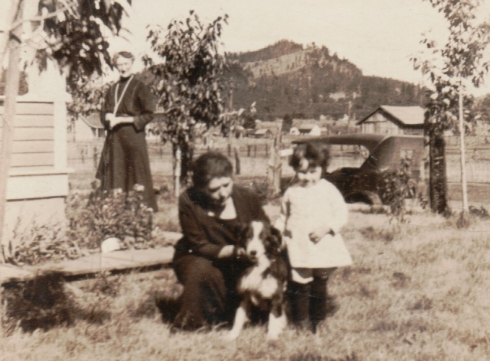 My grandmother, Goldie Simpson, on the right, about 2 years old, visiting relatives and their dog